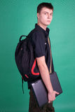 Student with laptop and backpack Royalty Free Stock Image