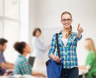 Student with laptop bag showing thumbs up Royalty Free Stock Image