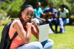 Student with laptop. Beautiful young black college student with laptop Stock Photo