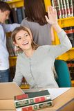 Student With Laptop And Books Waving In Library Stock Photos