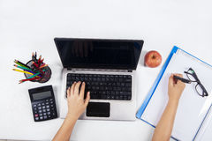 Student with laptop and school stationery 2 Royalty Free Stock Photos