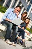 Student with laptop thinking Royalty Free Stock Image