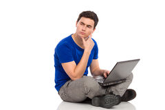 Student with laptop thinking. Royalty Free Stock Photo