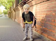 Student with large backpack near the school building. Back to school. Education stock photography