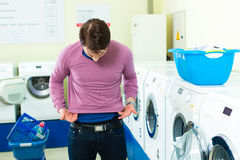 Student in a laundry with shrunk pullover Royalty Free Stock Photography