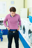 Student in a laundry with shrunk pullover Stock Photo