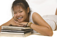 Student laying down with books Royalty Free Stock Photos