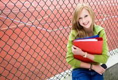 Student leaning against chainlink fence Stock Photos