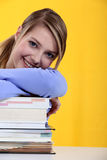 Student leaning on  books Royalty Free Stock Photos
