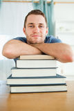Student leaning on his books Stock Photos