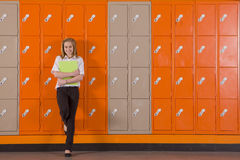 Student leaning on school lockers Royalty Free Stock Image