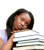 Student leaning on a stack of books Royalty Free Stock Images
