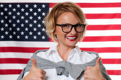 Student is learning English as a foreign language on American flag  background Royalty Free Stock Photography