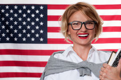 Student is learning English as a foreign language on American flag  background Stock Image