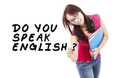 Student learning english 1. Learning language concept. Female student write Do You Speak English Royalty Free Stock Photos