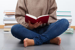 Student learning on a floor Royalty Free Stock Images