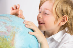Student learning geography with globe Royalty Free Stock Image