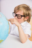 Student learning geography with globe Royalty Free Stock Photos