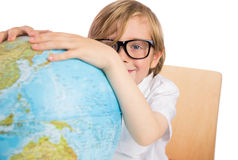 Student learning geography with globe Royalty Free Stock Images