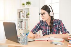 Student learning on line with headphones. And laptop. mixed race asian chinese model Royalty Free Stock Photography