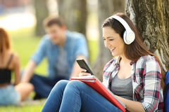 Student learning listening on line tutorials Stock Images