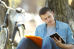 Student learning reading notes outside in a park Royalty Free Stock Photos