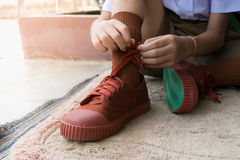 The student Leash shoelace new sneakers. Studen in new uniform try leash shoelace  new sneakers it a new experience first school start day Stock Photos
