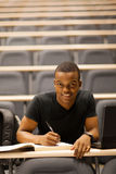 Student lecture hall. Male african american college student in lecture hall Royalty Free Stock Photos