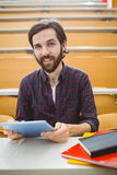 Student in lecture hall using tablet. At the university Royalty Free Stock Images