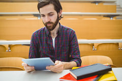Student in lecture hall using tablet. At the university Royalty Free Stock Image