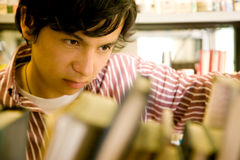 Student in a library Stock Images