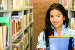 Student in a library Royalty Free Stock Photo