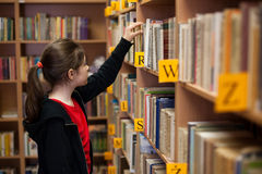 Student in library stock photo