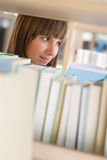 Student in library - happy woman study from book Stock Images