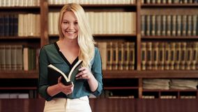 Student at the library stock footage