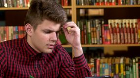Student  in a library, preparing for Abstracts stock video