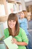 Student in library - two woman hold book Royalty Free Stock Photography