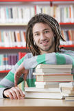 Student in library. Young friendly male student at the library Stock Images