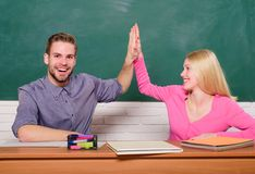 Student life. Lesson and blackboard. Teachers day. Couple of man and woman in classroom. Home schooling. Modern school. Student life. Lesson and blackboard royalty free stock photo