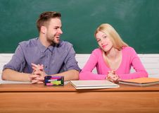 Student life. Lesson and blackboard. Teachers day. Modern school. Knowledge day. Couple of man and woman in classroom. Home schooling. Back to school. Happy royalty free stock photography