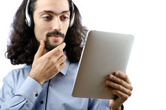 Student listening music with tablet. Computer Royalty Free Stock Photo