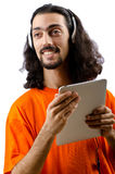 Student listening music with tablet. Computer Stock Photo