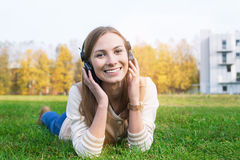 Student listening to headphones and smiling at camera. On the sunset royalty free stock photography