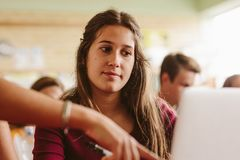 Student listening to the instruction from teacher royalty free stock image