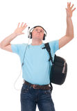 Student listening to music on headphone. Young student listening to music on headphone over a white background Stock Photo