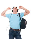 Student listening to music on headphone. Young student listening to music on headphone over a white background Stock Images