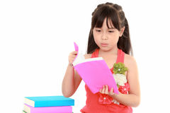 Student little asian girl reading Royalty Free Stock Photos
