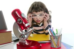 Student little girl with microscope and laptop Royalty Free Stock Photos