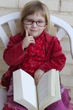 Student little girl reading bood Stock Photo