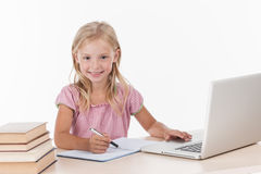 Student little school girl doing homework. Stock Image